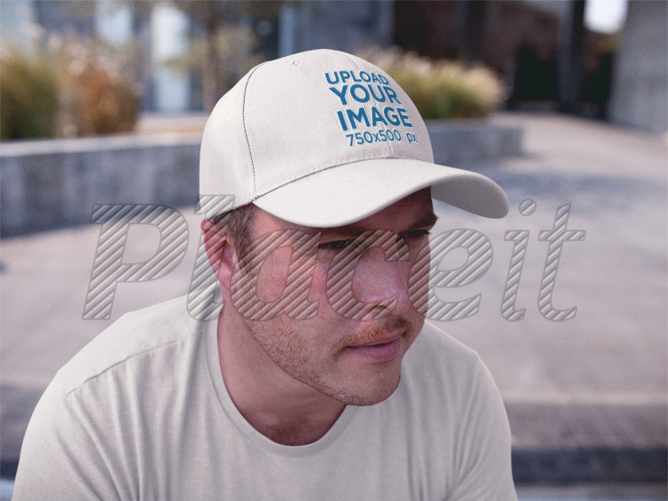 59d4e8ac4d7bb White Guy Wearing a Dad Hat Mockup While Sitting Down Outdoors  a15878Foreground Image