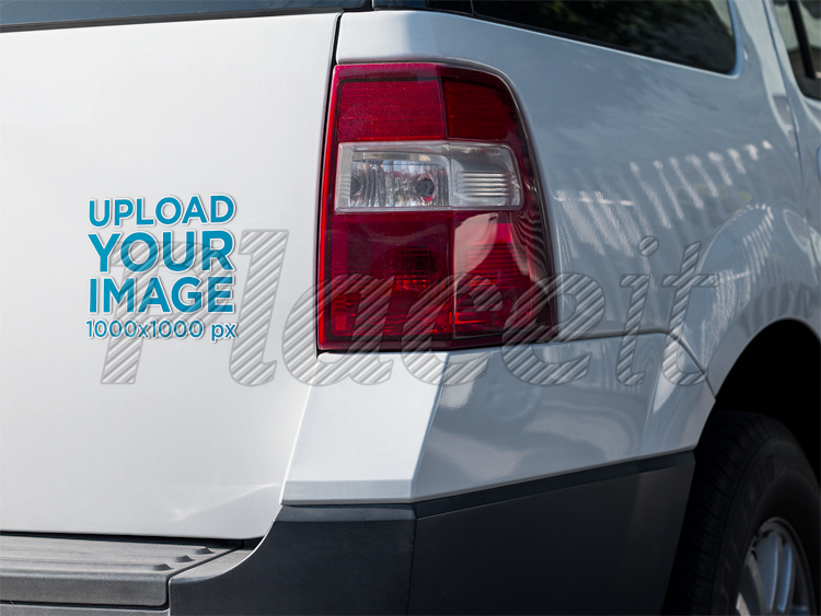 Square sticker mockup on the back of a white truck a15346foreground image