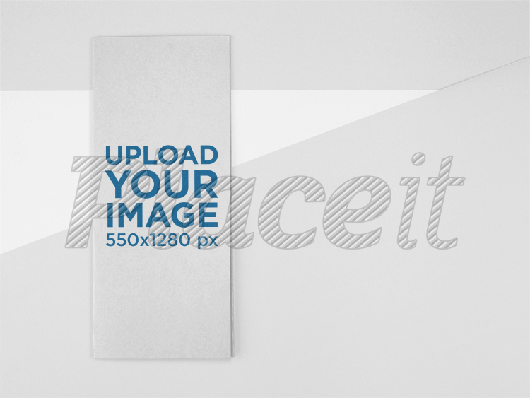 front of a trifold brochure mockup lying on a surface with soft colors a15208foreground image