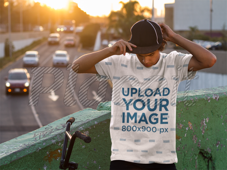7a7036082 Sublimated T-Shirt Mockup of a Guy With His Bike a8944Foreground Image