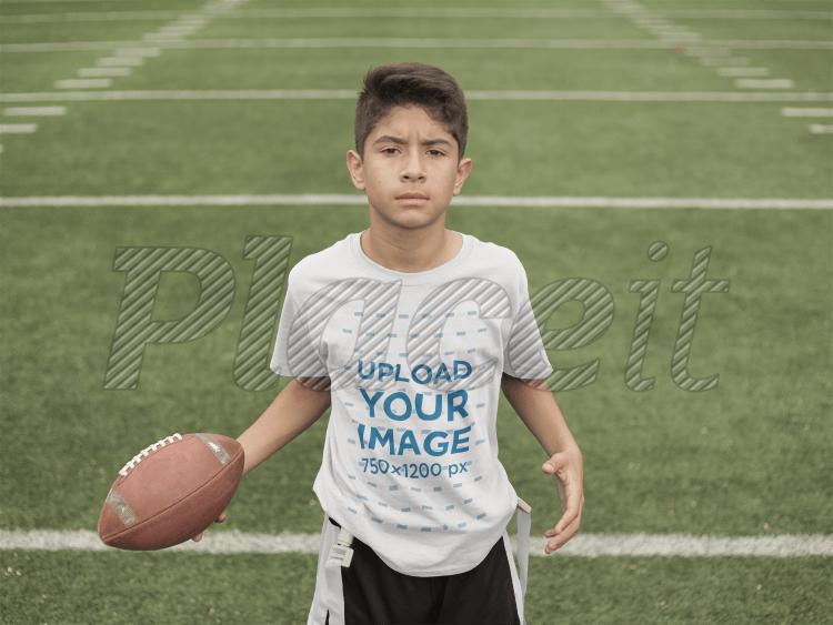 dc2e6e1bbfa Custom Football Jerseys - Kid Holding the Ball at the Field