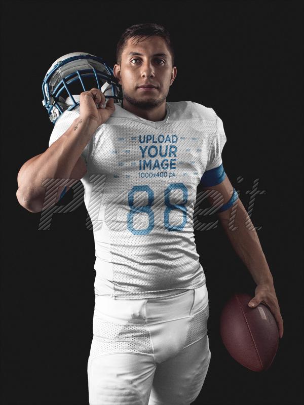a3cd5432e15 Custom Football Uniform Designer - Standing Man Holding Helmet and Football