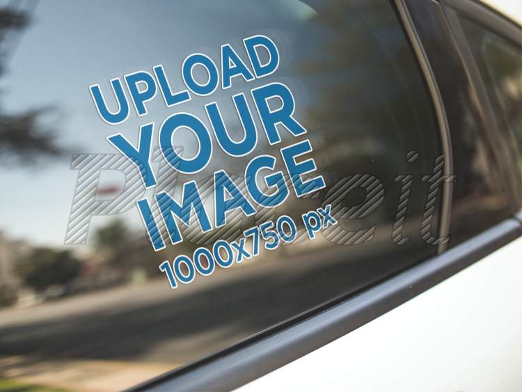 Mockup of a window decal on the back left door of a white car a14440foreground image