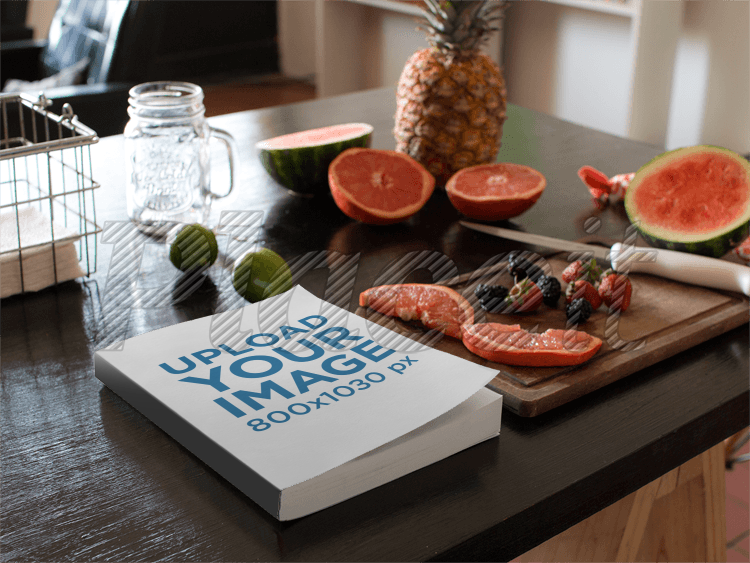 Placeit book lying on a kitchen table next to fruits and knife mockup book lying on a kitchen table next to fruits and knife mockup a14439foreground image workwithnaturefo