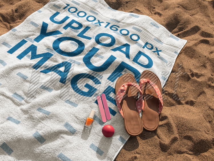 ce533d13f Beach Towel Mockup Lying on the Sand with Sandals and Accessories on it  a14890Foreground Image