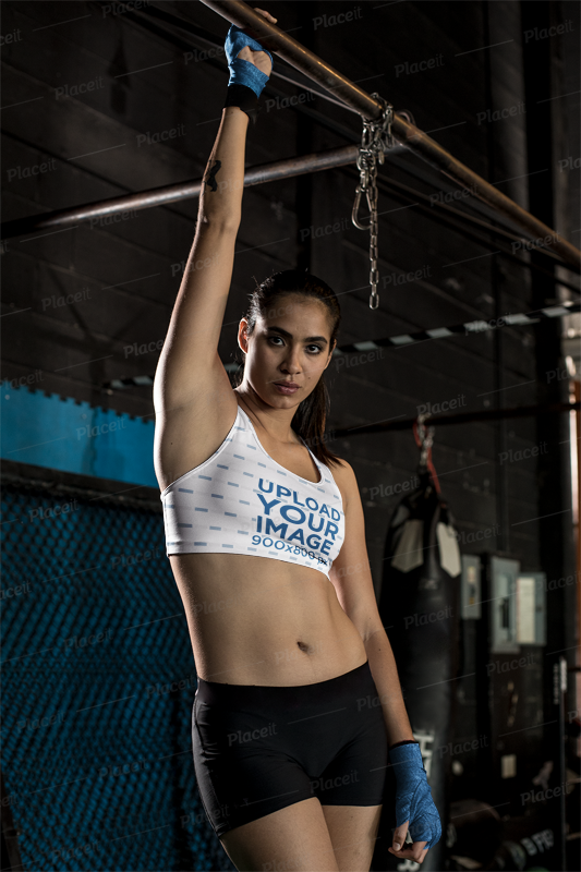 5f070368291 Placeit - Mockup of a Strong Woman Wearing a Sports Bra at the Gym