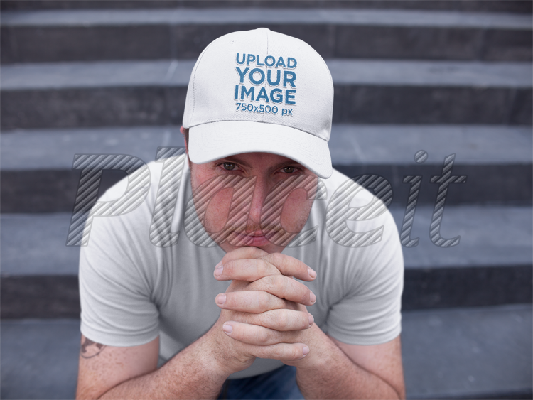 f6ed1812bc9fb White Guy Sitting Down on Concrete Stairs While Wearing a Dad Hat Mockup  a15881Foreground Image