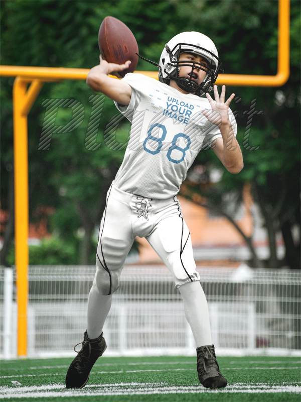 0ff5d97f1ae Placeit - Custom Football Jerseys - Boy Throwing the Ball at the Field